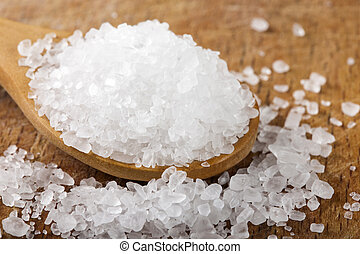 Close up of sea salt in wooden spoon