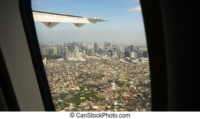 View from an airplane window.Manila, Philippines. - View...