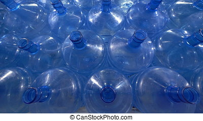 Great number of 19 liter plastic bottles. - Storage of big...