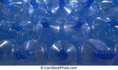 Great number of 19 liter plastic bottles. - Storage of big...