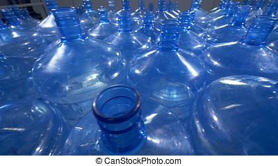 A lot of 19 liter plastic bottles for drinking water...