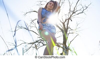 Sexy girl. Girl woman standing on nature sunlight in shorts...