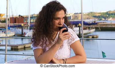 Young Caucasian woman drinking red wine - Lovely young...