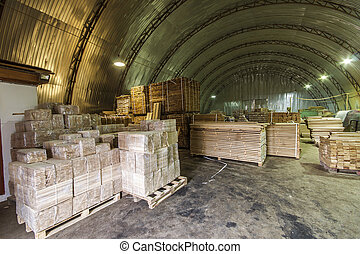 Warehouse packed with variety of timber for construction and...