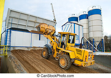 loader works at concrete plant - front-end loader loading...