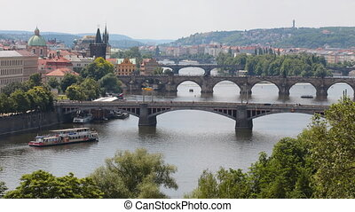 Time lapse shot of Prague from above. Bridges across the...