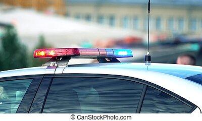 Police car light bar in action, telephoto lens shot