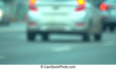 Blurred city street traffic. Telephoto lens bokeh motion...