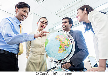 Businesspeople talk about global strategy - Asian...