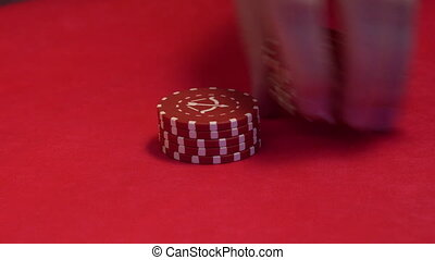Croupier makes trick with chips.