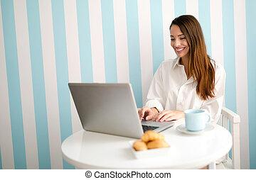 Beautiful woman reading news