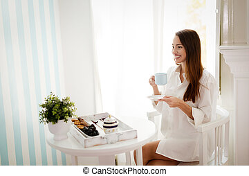 Romantic morning coffee by the window - Beautiful woman...