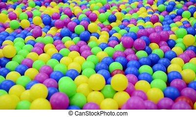 Multi-colored plastic balls.