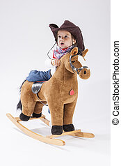 Children Consepts. Little Caucasian Girl Posing in Cowgirl...