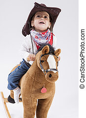 Children Consepts. Little Cheerful Caucasian Girl in Cowgirl...