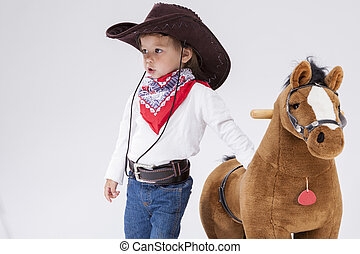 Little Children Consepts. Caucasian Girl in Cowgirl Clothing...