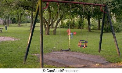 an empty Playground with swings
