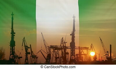 Industrial concept with Nigeria flag at sunset