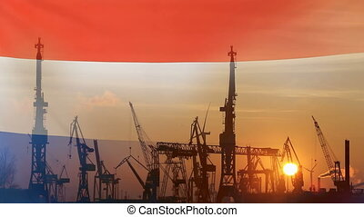 Industrial concept with Netherlands flag at sunset,...