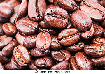 Roasted Brown coffee beans close up  Background.