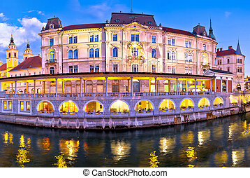 Ljubljana riverfront architecture evening view, capital of...