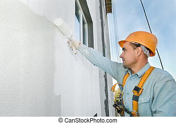 builder facade painter at work - builder worker painting...