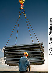 handling load lifting operations - laborer and pallets in...