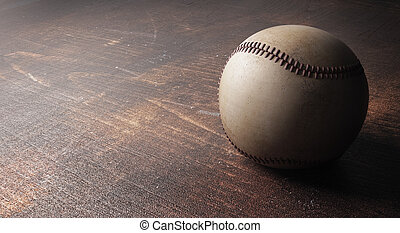 Baseball on wooden surface - Close up of baseball on wooden...