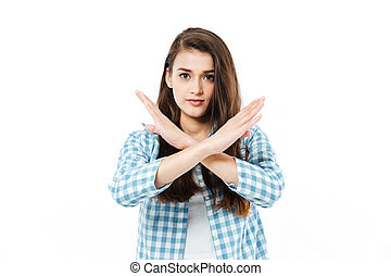 Young pretty girl cross her arms to show gesture no - Young...