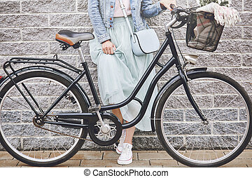 Low section of woman's legs with bike