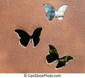 Butterfly metal work. Cast iron plate with artistic butterly...