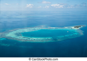 Tropical islands and atolls in Maldives from aerial view