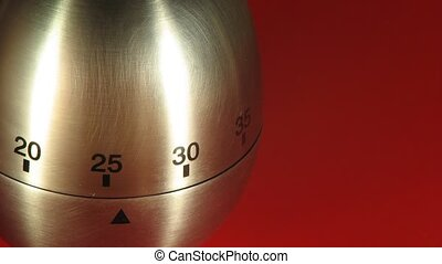 Egg Kitchen Timer on a Red Table - Egg kitchen timer counts...