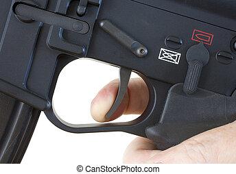 Finger on the trigger - finger on the trigger of a black...