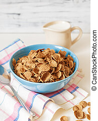 Wheat buckwheat bran breakfast cereal with milk in ceramic bowl