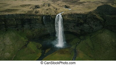 Copter flying away from the Seljalandsfoss waterfall....