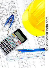 construction drawing - pencil and calculator over a...