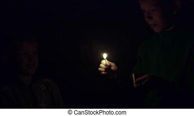 Children light matches in the dark
