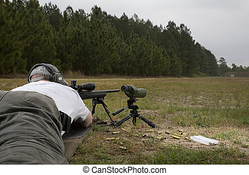 prone marksman - shooter who is on the group trying to hit...