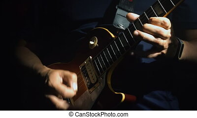 Man's hands playing electric guitar - Closeup of man's hands...