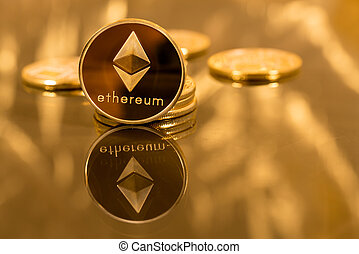 Stack of ethereum coins with gold background - Stack of...