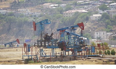 Oil Pumps, Pump jack. Fossil Fuel Energy, Old Pumping Unit -...