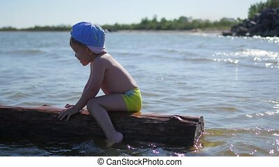 A happy child swims in the sea. Fun and games outdoors