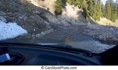 Travel by car on broken roads of Svaneti. Road trip through...