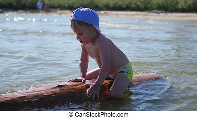 A happy child plays in the sea. Fun and games outdoors