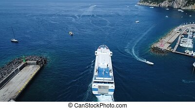 passenger ship in Capri harbor - flight over Capri harbor in...