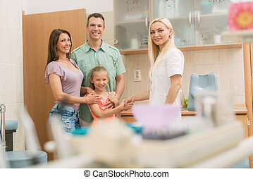 At The Dentist - Little girl and her parents visiting...