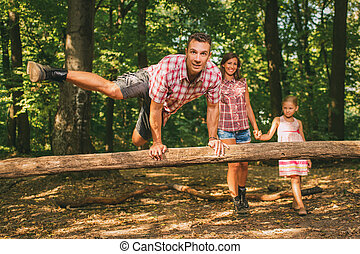 Crazy Family In The Forest - Beautiful young family having...