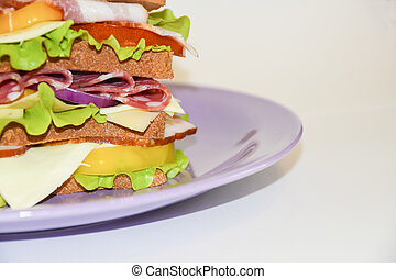 Tall sandwich violet plate beef pork tomato white background
