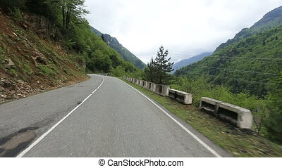 Travel by car on the roads of Svaneti. Road trip through forests and mountains. Georgia.